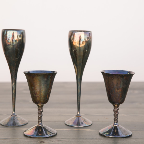 Vintage Metal Champagne Flutes And Wine Goblets Out Of The Dust